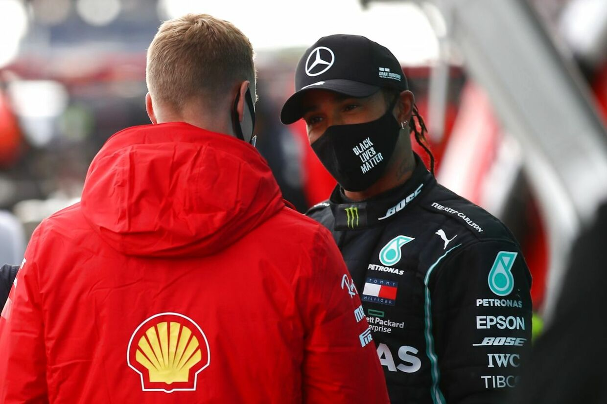 Alfa Romeo's German driver Mick Schumacher (L) talks to winner Mercedes' British driver Lewis Hamilton after the German Formula One Eifel Grand Prix at the Nuerburgring circuit in Nuerburg, western Germany, on October 11, 2020. (Photo by Bryn Lennon / POOL / AFP)