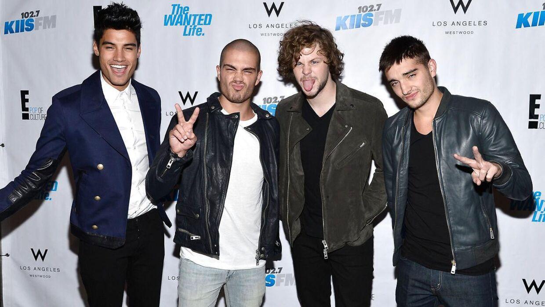 Helt til højre Tom Parker. Til venstre for ham står resten af det britiske boyband The Wanted.