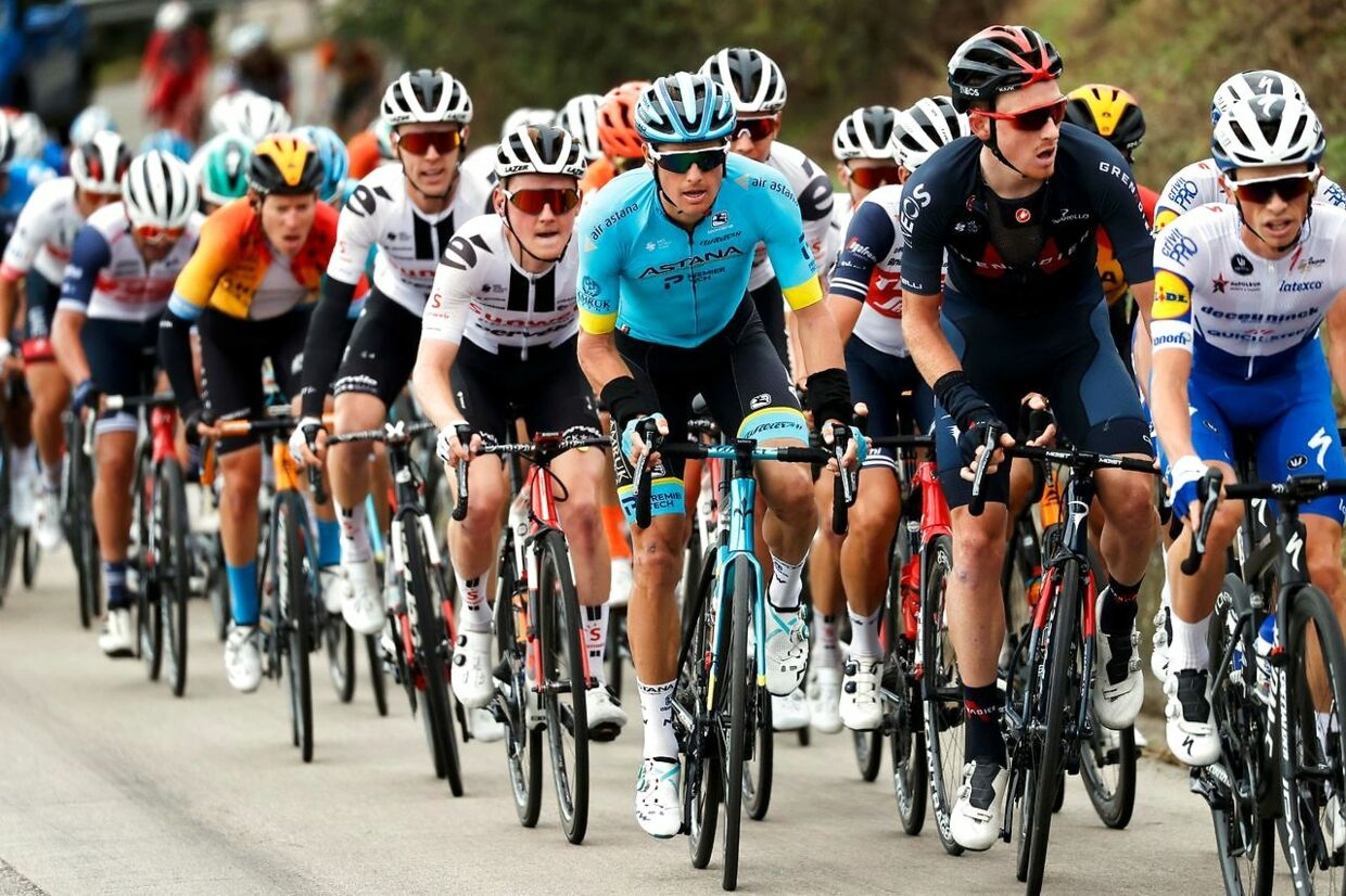 Team Astana rider Denmark's Jakob Diemer Fuglsang (C), wearing the blue jersey, rides with the peloton during the 10th stage of the Giro d'Italia 2020 cycling race, a 177-kilometer route between Lanciano and Tortoreto, on October 13, 2020. (Photo by Luca Bettini / AFP)