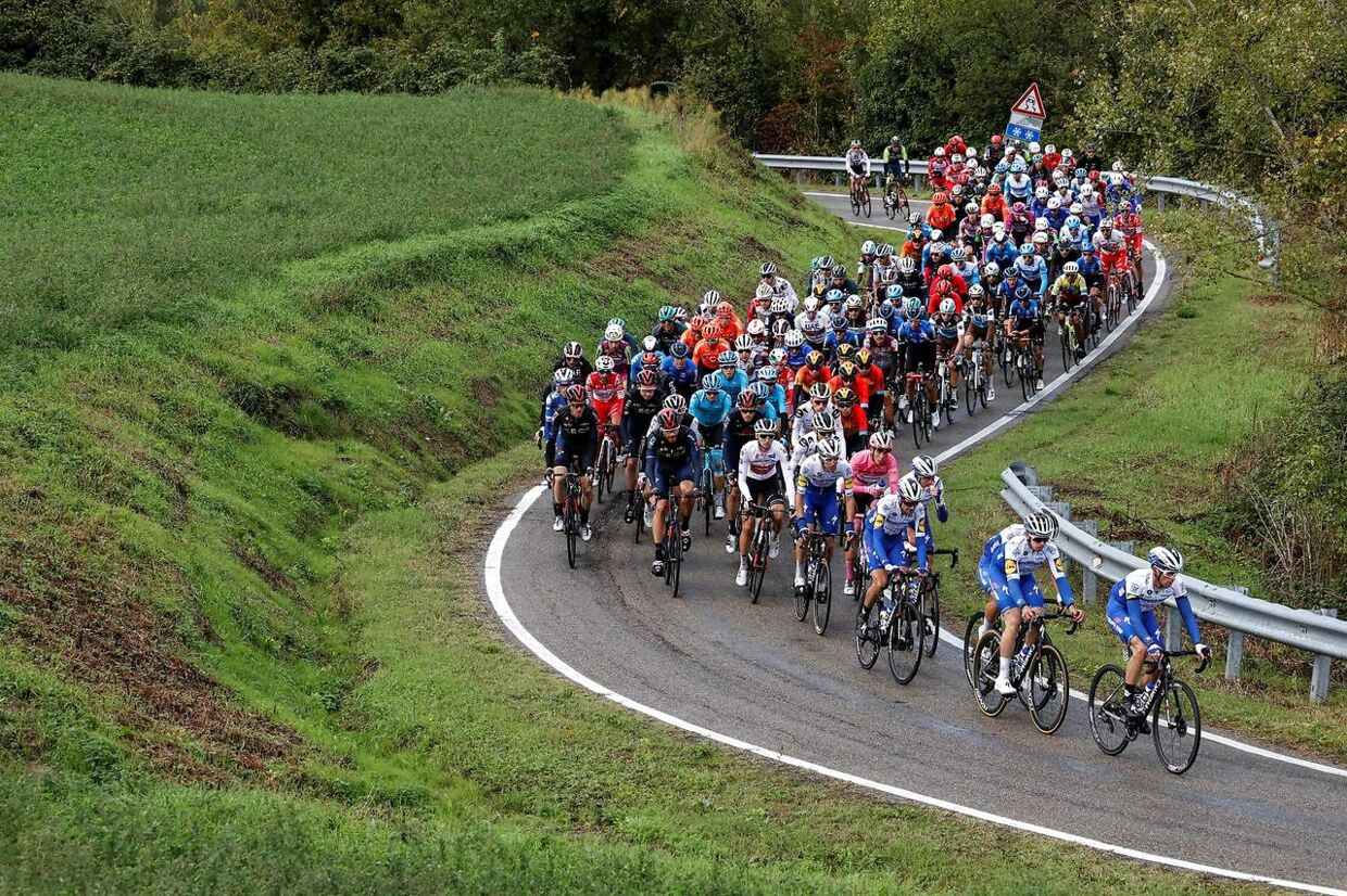 The pack rides during the 12th stage of the Giro d'Italia 2020 cycling race, a 204-kilometre route between Cesenatico and Cesenatico, on October 15, 2020. (Photo by Luca Bettini / AFP)
