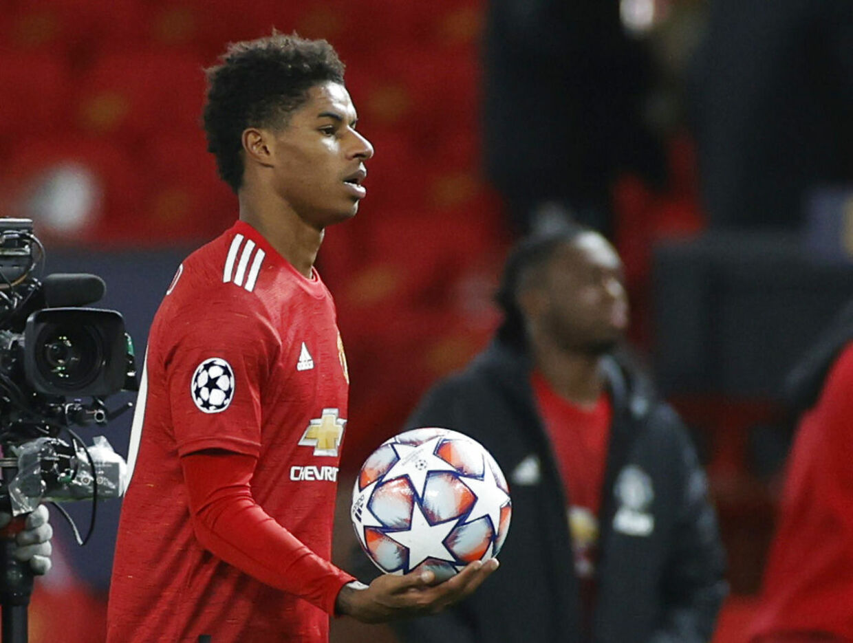 Soccer Football - Champions League - Group H - Manchester United v RB Leipzig - Old Trafford, Manchester, Britain - October 28, 2020 Manchester United's Marcus Rashford celebrates with the match ball after the match REUTERS/Phil Noble