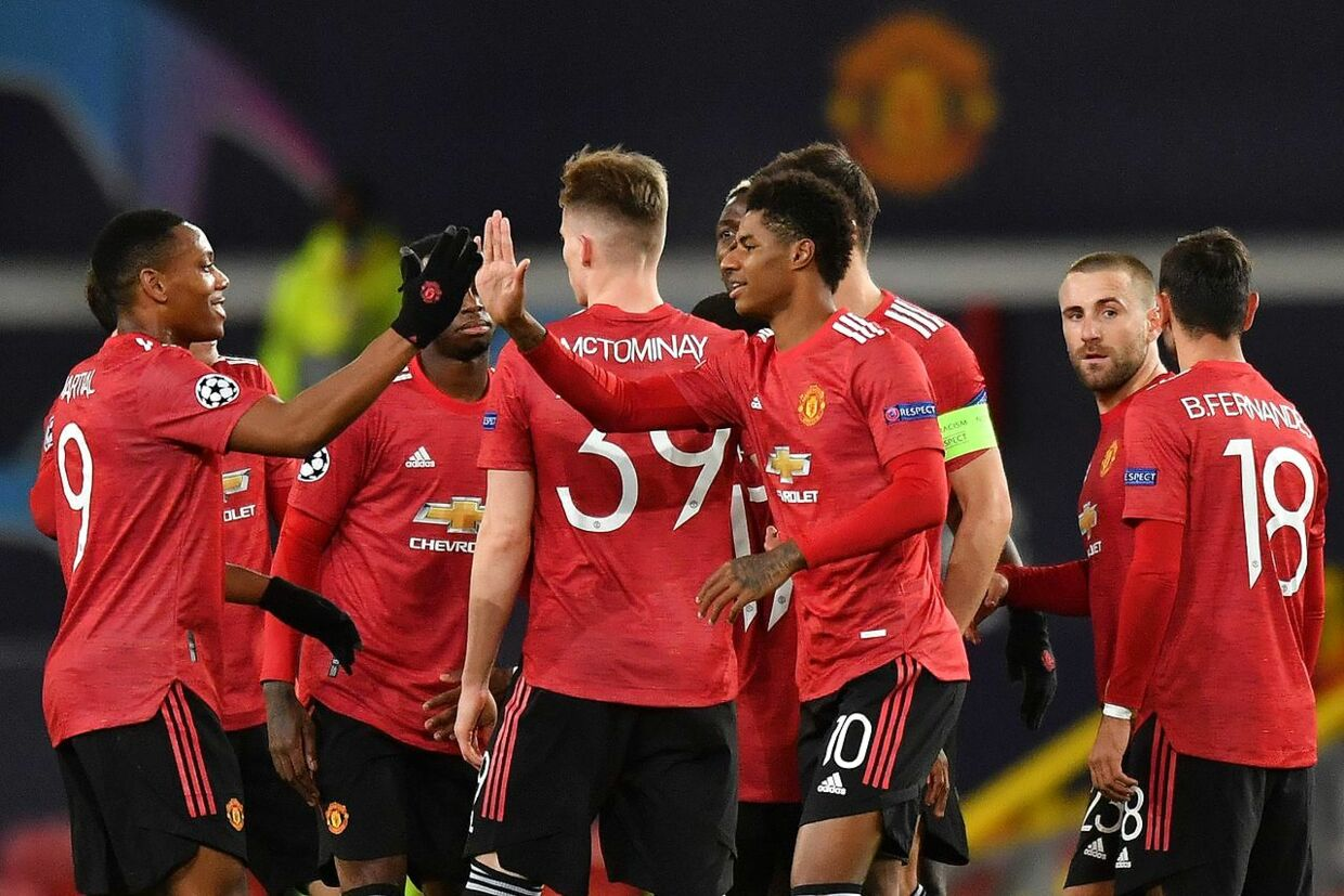 Manchester United's English striker Marcus Rashford (C) celebrates scoring his team's second goal during the UEFA Champions league group H football match between Manchester United and RB Leipzig at Old Trafford stadium in Manchester, north west England, on October 28, 2020. (Photo by Anthony Devlin / AFP)