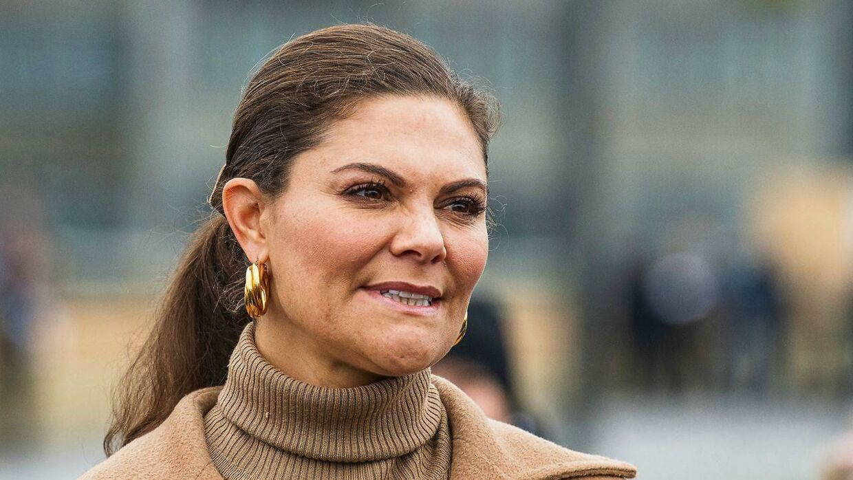 """Crown Princess Victoria of Sweden is pictured on the golden bridge """"Slussbron"""" after its inauguration in Stockholm on October 25, 2020. (Photo by Jonathan NACKSTRAND / AFP)"""