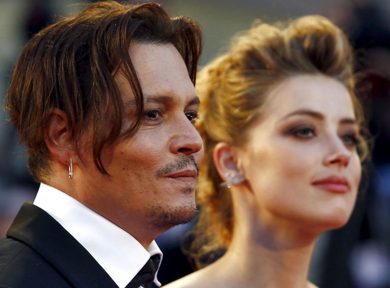 Amber Heard og Johnny Depp, mens de stadig var gift i september 2015.