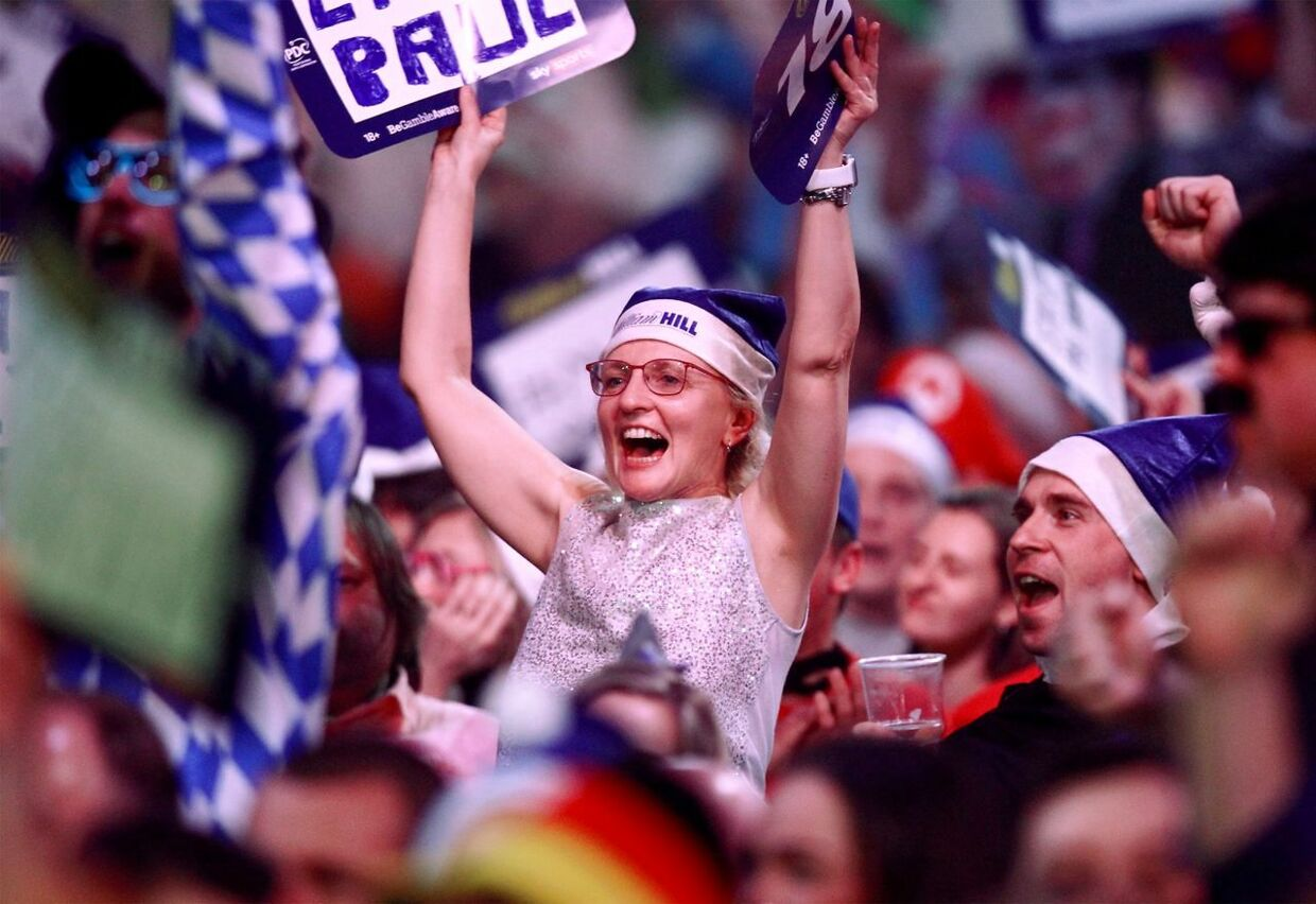 epa06410833 Fans celebrate during the PDC World darts semi final match between Englishman Rob Cross and Dutchman Michael van Gerwen both (not pictured) at the Alexander Palace in north London, Britain, 30 December 2017. EPA/SEAN DEMPSEY