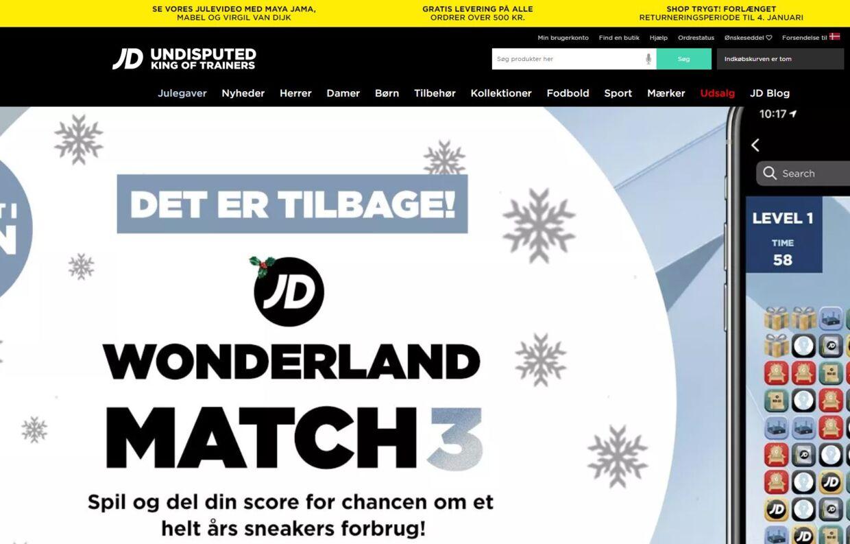 Et udsnit af JD Sports danske hjemmeside. Bemærk vendingen 'shop trygt' i øverste højre hjørne.