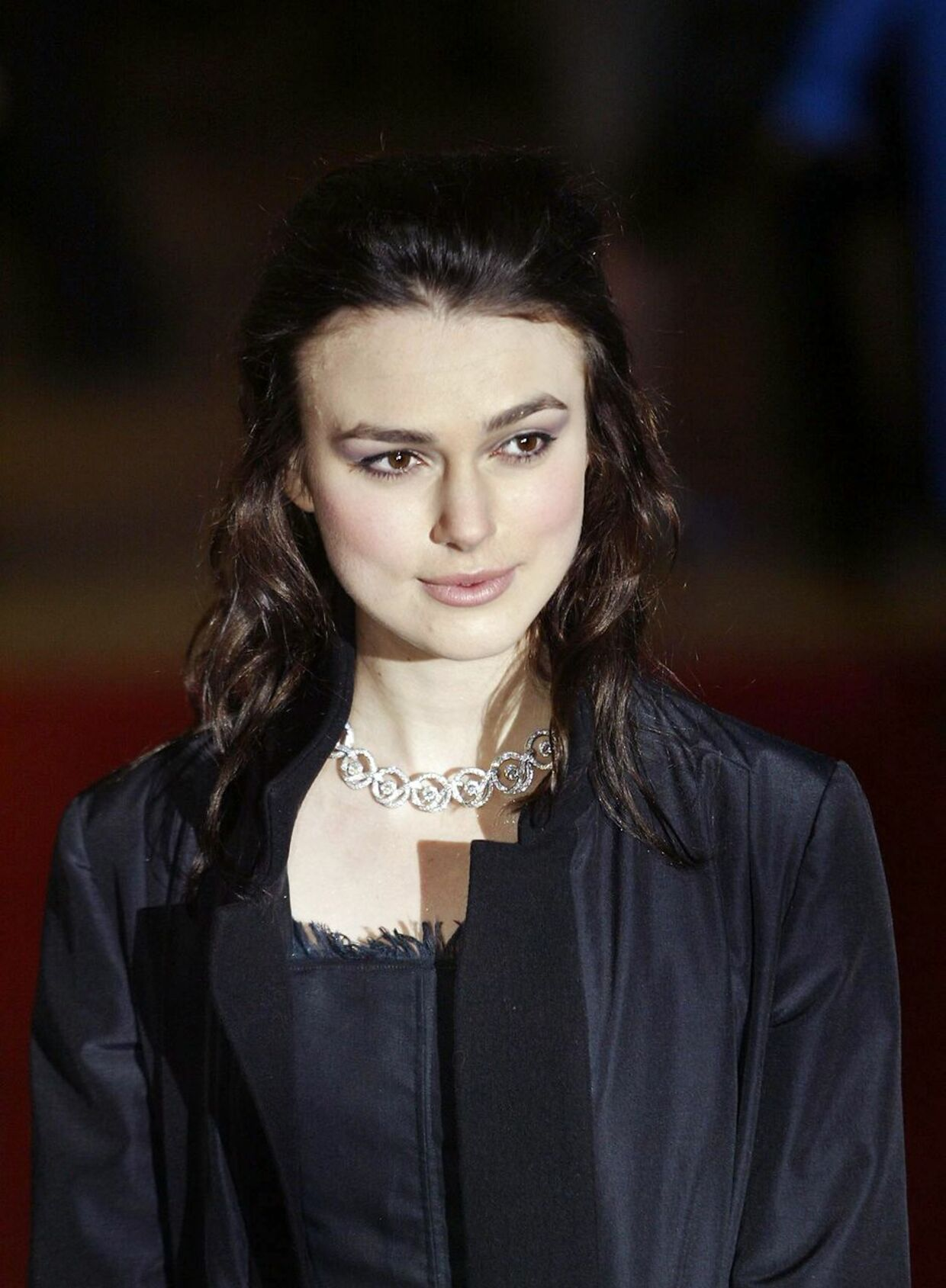 """Actress Kiera Knightley arrives for the UK premiere of the film """"Love Actually"""", at the Odeon Cinema, Leicester Square in London, 16 November 2003. """"Love Actually"""" is the latest film from director Richard Curtis, who also made """"Four Weddings and a Funeral"""" and """"Notting Hill"""". AFP PHOTO/ALESSANDRO ABBONIZIO ALESSANDRO ABBONIZIO / AFP"""