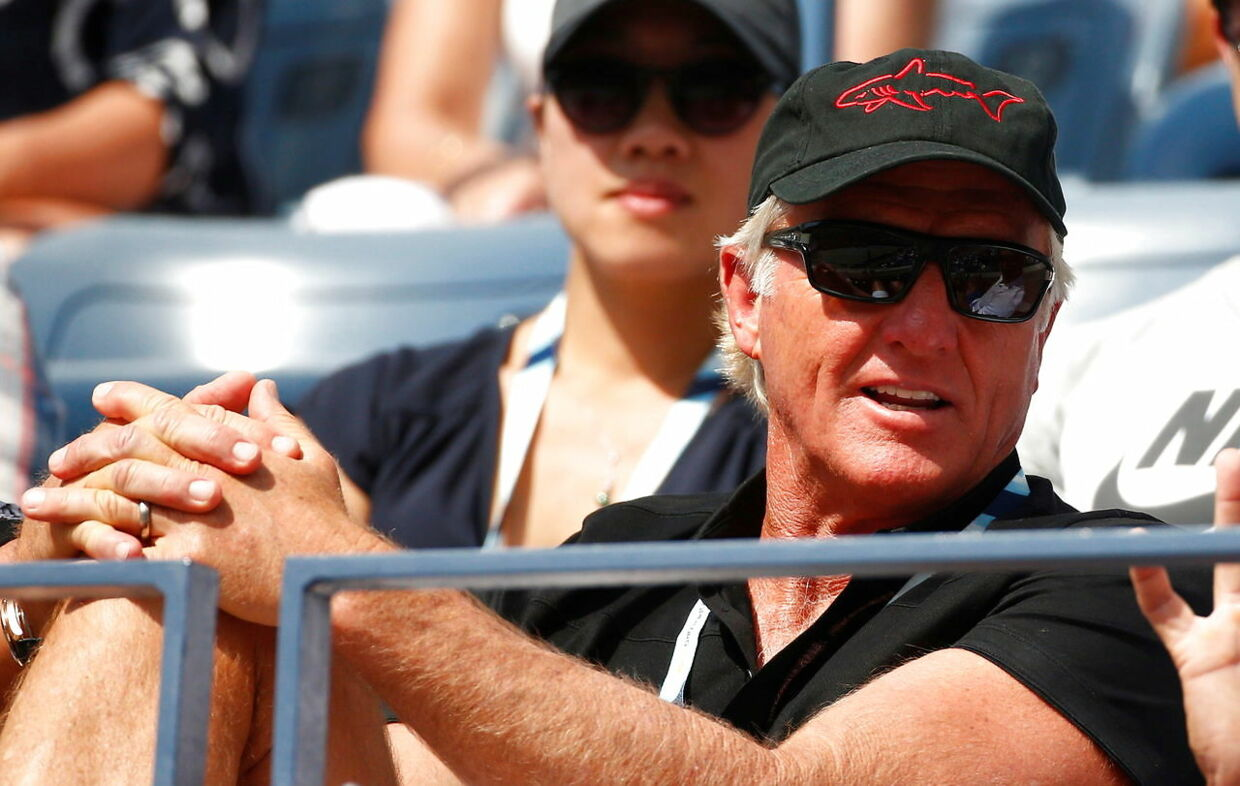 FILE PHOTO: Golfer Greg Norman of Australia watches the fourth round match between Grigor Dimitrov of Bulgaria and Gael Monfils of France at the 2014 U.S. Open tennis tournament in New York, September 2, 2014. REUTERS/Adam Hunger/File Photo