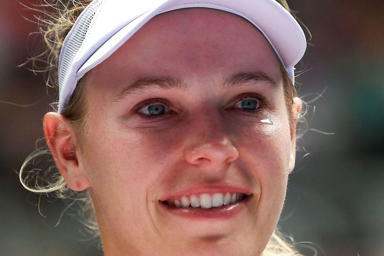 Denmark's Caroline Wozniacki reacts after defeat against Tunisia's Ons Jabeur during their women's singles match on day five of the Australian Open tennis tournament in Melbourne on January 24, 2020. Et af dansk idræts største navne og en international stjerne takkede af, hvor hun i 2018 vandt sin største sejr. Caroline Wozniacki fik den afsked, hun ønskede. Det skriver Ritzau, fredag den 24. januar 2020.. (Foto: GREG WOOD/Ritzau Scanpix)