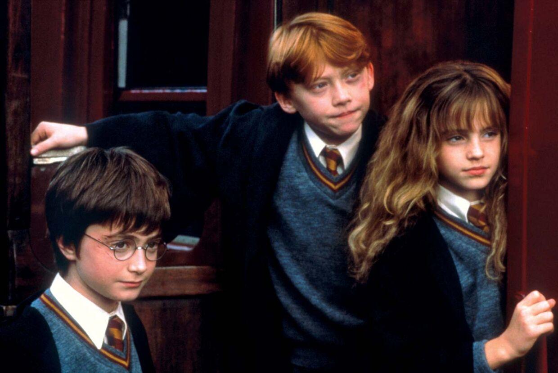 Daniel Radcliffe (11), Rupert Grint (12) og Emma Watson (10) i den første film om Harry Potter.