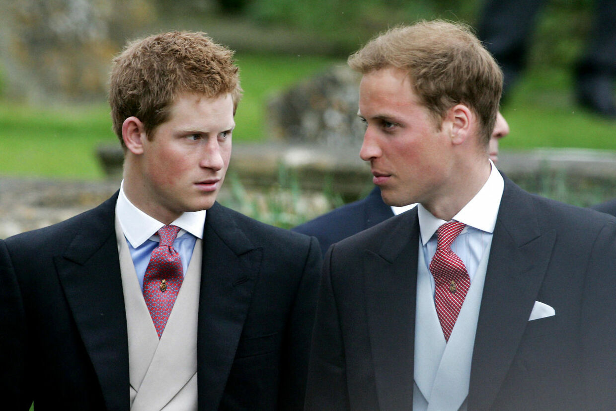 "(FILES) In this file photo taken on May 06, 2006 Prince Harry (L), and Prince William (R) leave Lacock Cyraiax Church after the wedding of Laura Parker-Bowles, daughter of Camilla Parker-Bowles, Duchess of Cornwall, and Harry Lopes, 06 May 2006. - Prince Harry, who became the father of a ""very healthy boy"" on Monday, has transformed himself from an angry young man into one of the British royal family's greatest assets. (Photo by Carl DE SOUZA / AFP)"