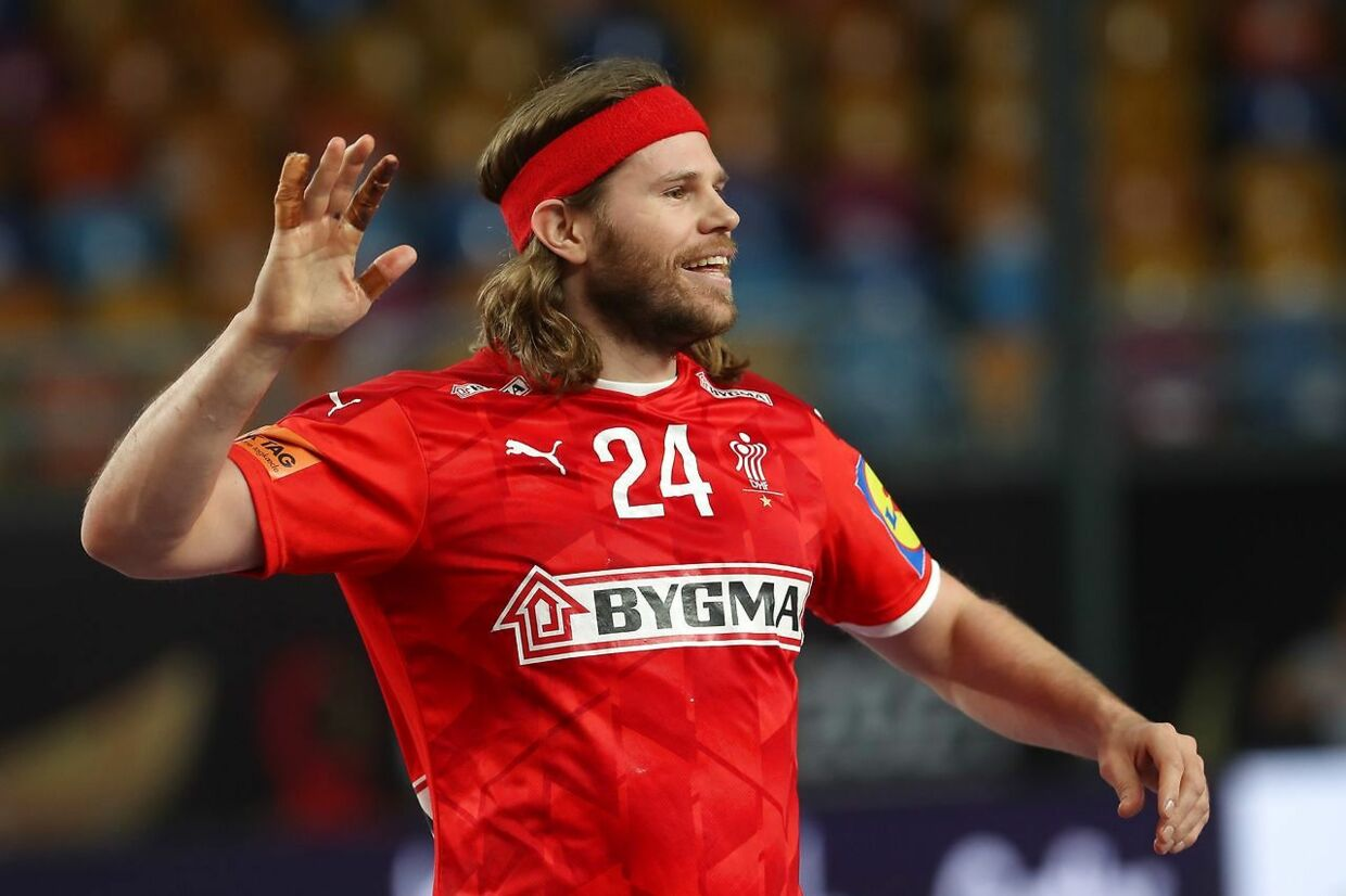 Denmark's left back Mikkel Hansen reacts during the 2021 World Men's Handball Championship between Group II teams Denmark and Qatar at the Cairo Stadium Sports Hall in the Egyptian capital on January 21, 2021. (Photo by MOHAMED ABD EL GHANY / POOL / AFP)