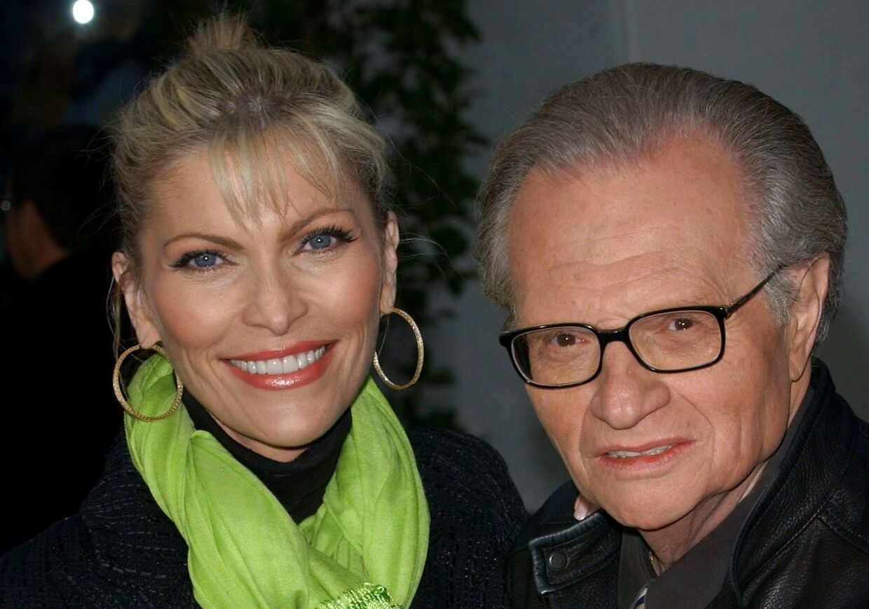 """In this file photo taken on May 14, 2003, TV and radio interviewer Larry King and his wife Shawn Southwick arrive for the premiere of """"Bruce Almighty"""" at Universal Citywalk in Los Angeles. - The iconic TV and radio interviewer Larry King died January 23, 2021, at the age of 87, his media company said. Ora Media did not state a cause of death but media reports said King had been battling Covid-19 for weeks and had suffered several health problems in recent years. (Photo by Chris DELMAS / AFP)"""