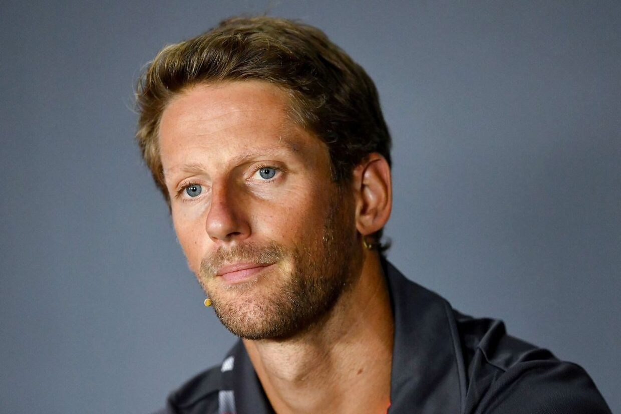 (FILES) In this file photo taken on August 30, 2018 Haas F1's French driver Romain Grosjean addresses a press conference at the Autodromo Nazionale circuit in Monza on August 30, 2018 ahead of the Italian Formula One Grand Prix. Romain Grosjean is returning home to Switzerland for treatment on the burns he suffered from his fireball crash in Bahrain and will miss the season-closing Abu Dhabi Grand Prix, his Haas team announced on December 6. (Photo by ANDREJ ISAKOVIC / AFP)