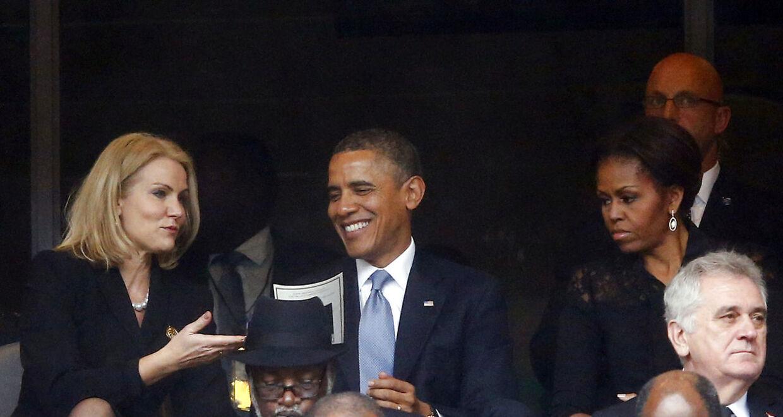 En af årsagerne til, at den sjove episode mellem Obama og Thorning gik verden rundt var også, at Michelle Obama - mere eller mindre bevidst - ser ekstrem sur ud, mens hendes mand morer sig med Thorning.