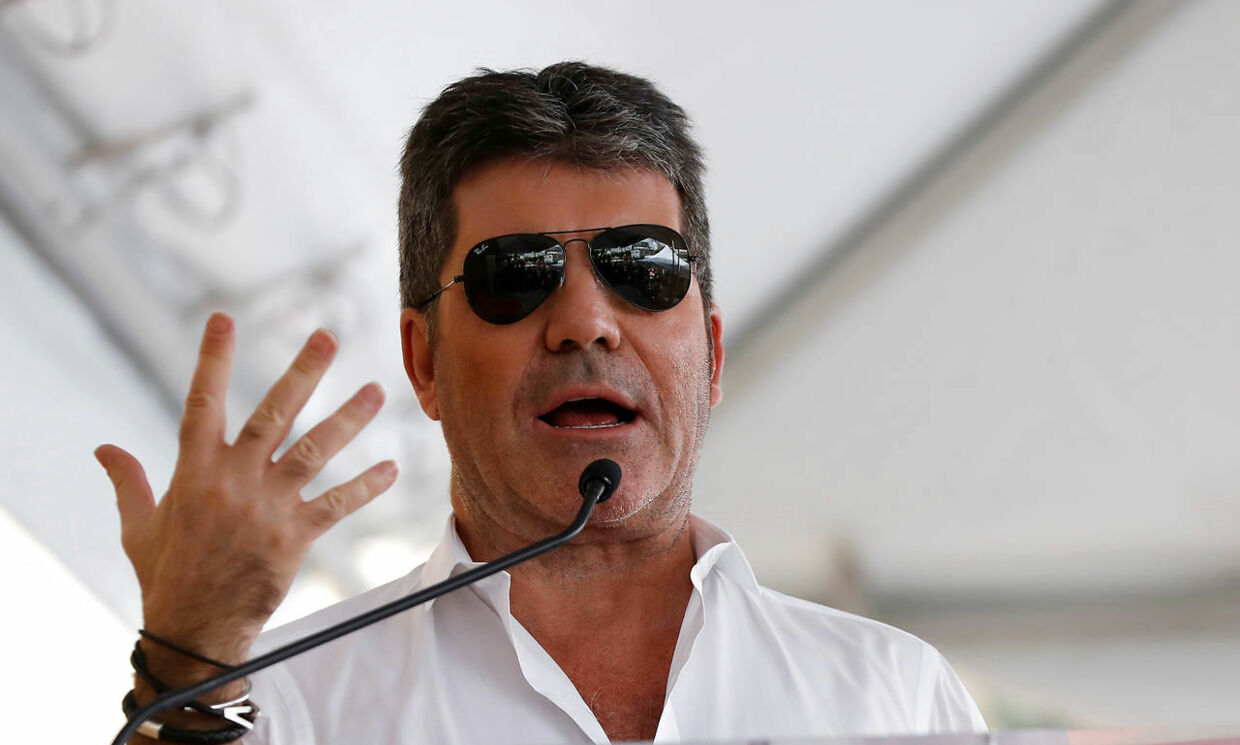 Producer Simon Cowell speaks at the unveiling of the star for Israeli-American producer Haim Saban on the Hollywood Walk of Fame in Los Angeles, California U.S., March 22, 2017. REUTERS/Mario Anzuoni
