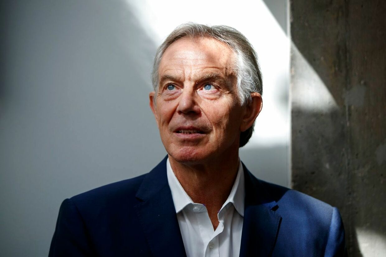"""(FILES) In this file photo taken on July 17, 2018 Former British Prime Minister Tony Blair poses for a photograph ahead of an interview with AFP in central London. - Former British prime minister Tony Blair urged his Labour party on December 18, 2019, to abandon """"crazy revolutionary socialism"""" as it seeks a new leader after its worst election defeat since the 1930s. Britain's shellshocked left entered a period of soul-searching and mourning in the wake of last Thursday's drubbing at the polls. (Photo by Tolga AKMEN / AFP)"""