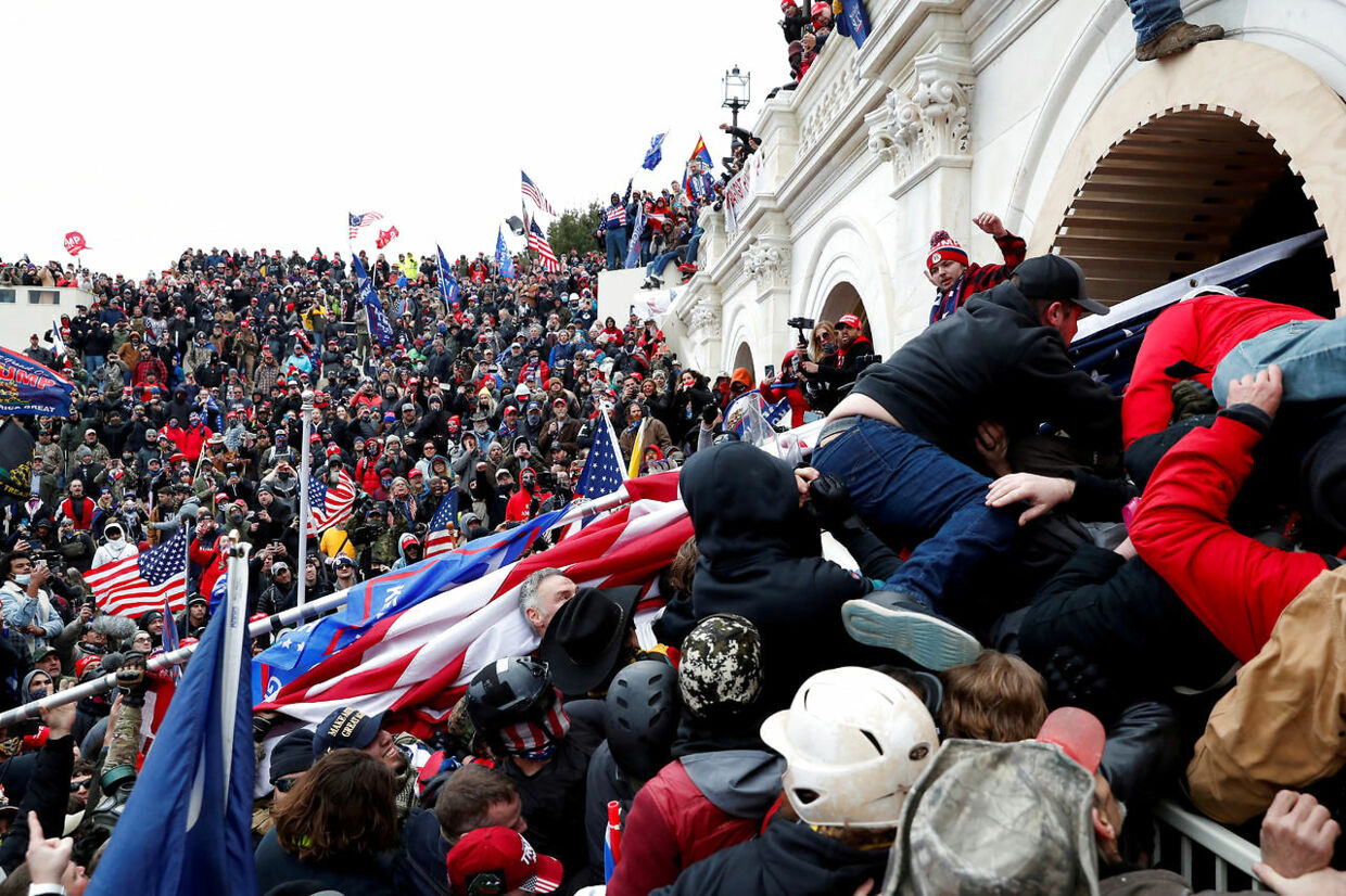 FILE PHOTO: Pro-Trump protesters storm into the U.S. Capitol during clashes with police, during a rally to contest the certification of the 2020 U.S. presidential election results by the U.S. Congress, in Washington, U.S, January 6, 2021. REUTERS/Shannon Stapleton TPX IMAGES OF THE DAY/File Photo