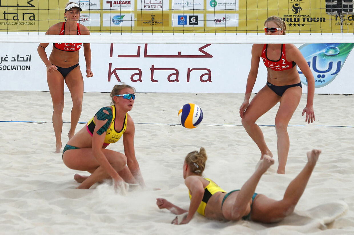 Germany (yellow) and Norway (red) compete during the Katara Beach Volleyball cup part of the FIVB World Tour in the Qatari capital Doha on March 8, 2021. (Photo by KARIM JAAFAR / AFP)