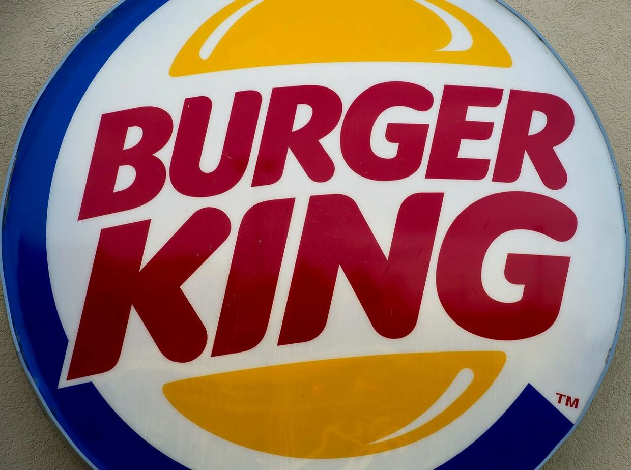 """(FILES) This file photo shows the Burger King restaurant logo in Chantilly, Virginia on January 2, 2015. - For those seeking to tackle climate change and get a fast food fix, Burger King has the answer - - a Whopper from cows that fart and burp less. The fast-food giant announced on July 14, 2020 that select restaurants in five US cities - - New York, Miami, Portland, Los Angeles and Austin, Texas - - would be serving Whoppers made from """"reduced methane emissions"""" beef. (Photo by Paul J. RICHARDS / AFP)"""