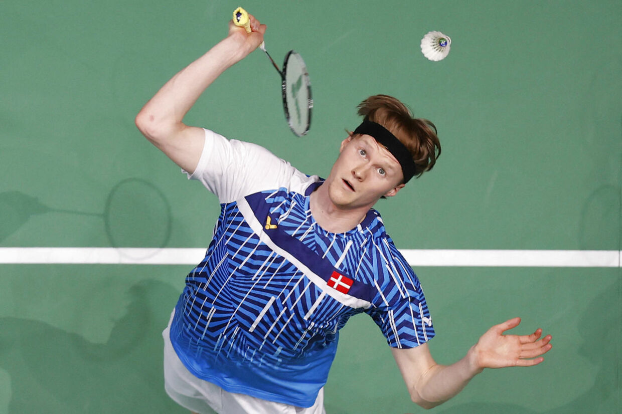 Denmark's Anders Antonsen returns to Japan's Kanta Tsuneyama during a men's singles quarter-final match on day three of the All England Open Badminton Championship, at the Utilita Arena in Birmingham, central England, on March 19, 2021. (Photo by Adrian DENNIS / AFP)