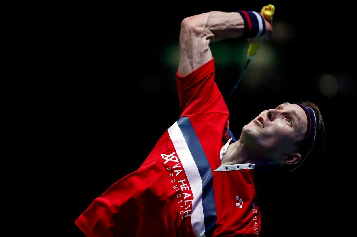 Denmark's Viktor Axelsen serves against Denmark's Anders Antonsen during their men's singles semi-final match on day four of the All England Open Badminton Championship at the Utilita Arena in Birmingham, central England, on March 20, 2021. (Photo by Adrian DENNIS / AFP)