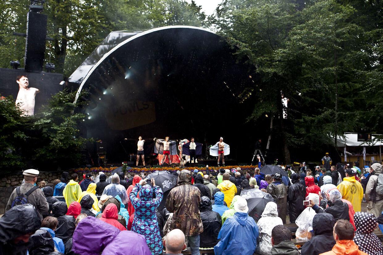 ARKIVFOTO 2011 af regnvejr på Smukfest 2013 Skanderborg Festival 2013. Se RB 1/8 2016 06.49. Det ustadige vejr fortsætter, og der kan ventes regn og kulde til festivalgængerne på Skanderborg Festival. (Foto: Malte Kristiansen/Scanpix 2013)