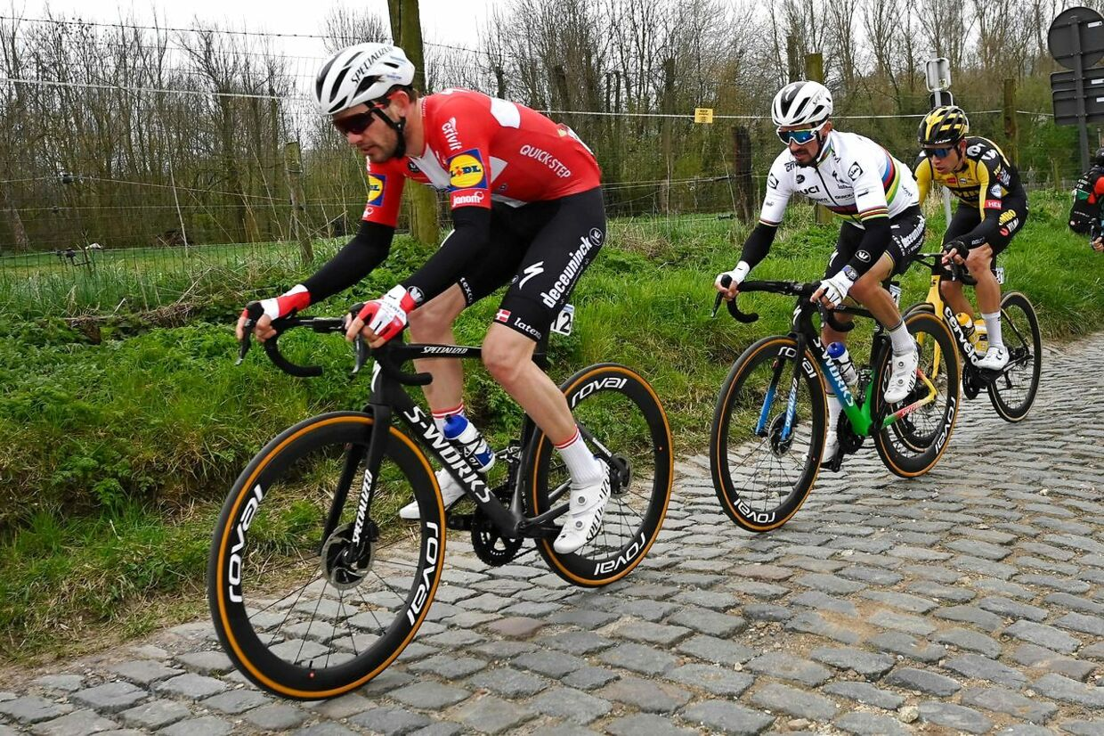 "Danish Kasper Asgreen of Deceuninck-Quick-Step, French Julian Alaphilippe of Deceuninck-Quick-Step and Belgian Wout Van Aert of Team Jumbo-Visma team compete on the Molenberg in the 105th edition of the ""Ronde van Vlaanderen, Tour of Flanders"" one day cycling race, from Antwerp to Oudenaarde, on April 4, 2021. (Photo by DIRK WAEM / various sources / AFP) / Belgium OUT"