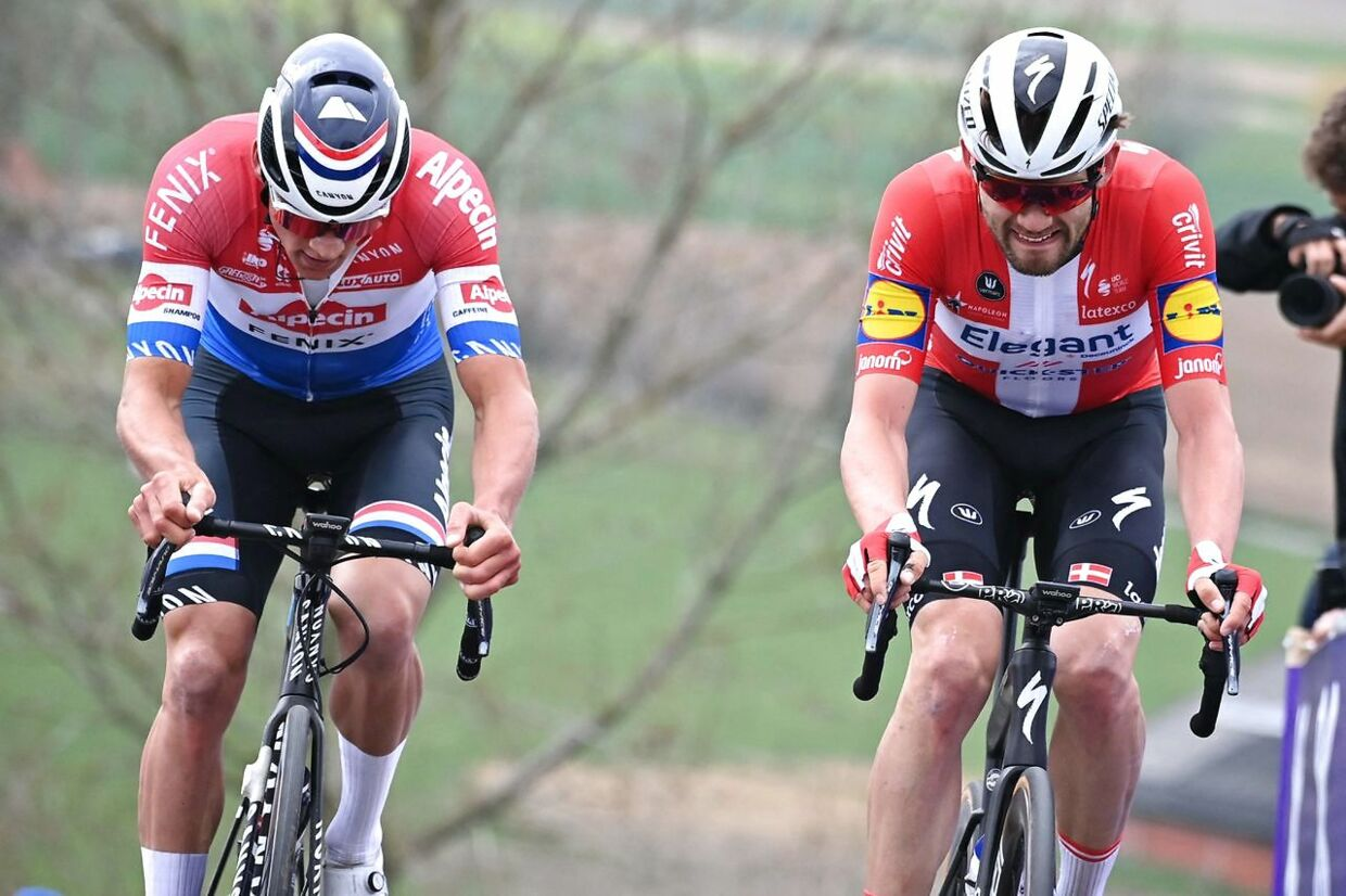 "Dutch Mathieu Van der Poel of Alpecin-Fenix and Danish Kasper Asgreen of Deceuninck-Quick-Step compete in the 105th edition of the ""Ronde van Vlaanderen, Tour of Flanders"" one day cycling race, from Antwerp to Oudenaarde, on April 4, 2021. (Photo by DAVID STOCKMAN / various sources / AFP) / Belgium OUT"