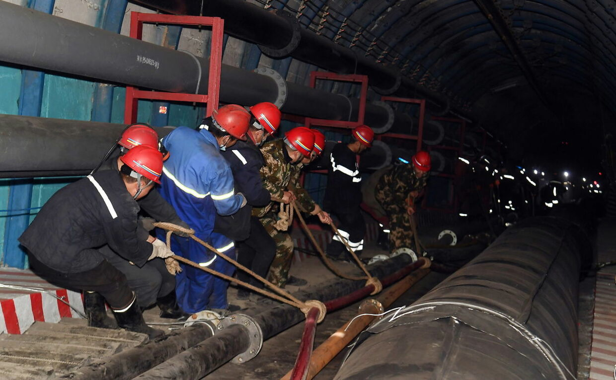 Rescuers work at the site where a coal mine flooded in Hutubi county, Xinjiang Uighur Autonomous Region, China April 11, 2021. China Daily via REUTERS ATTENTION EDITORS - THIS IMAGE WAS PROVIDED BY A THIRD PARTY. CHINA OUT.