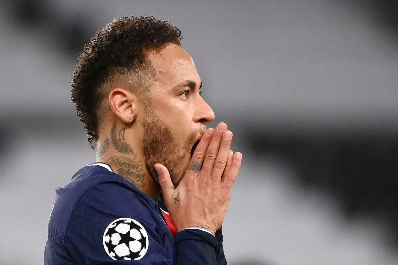 Paris Saint-Germain's Brazilian forward Neymar reacts during the UEFA Champions League quarter-final second leg football match between Paris Saint-Germain (PSG) and FC Bayern Munich at the Parc des Princes stadium in Paris, on April 13, 2021. (Photo by FRANCK FIFE / AFP)