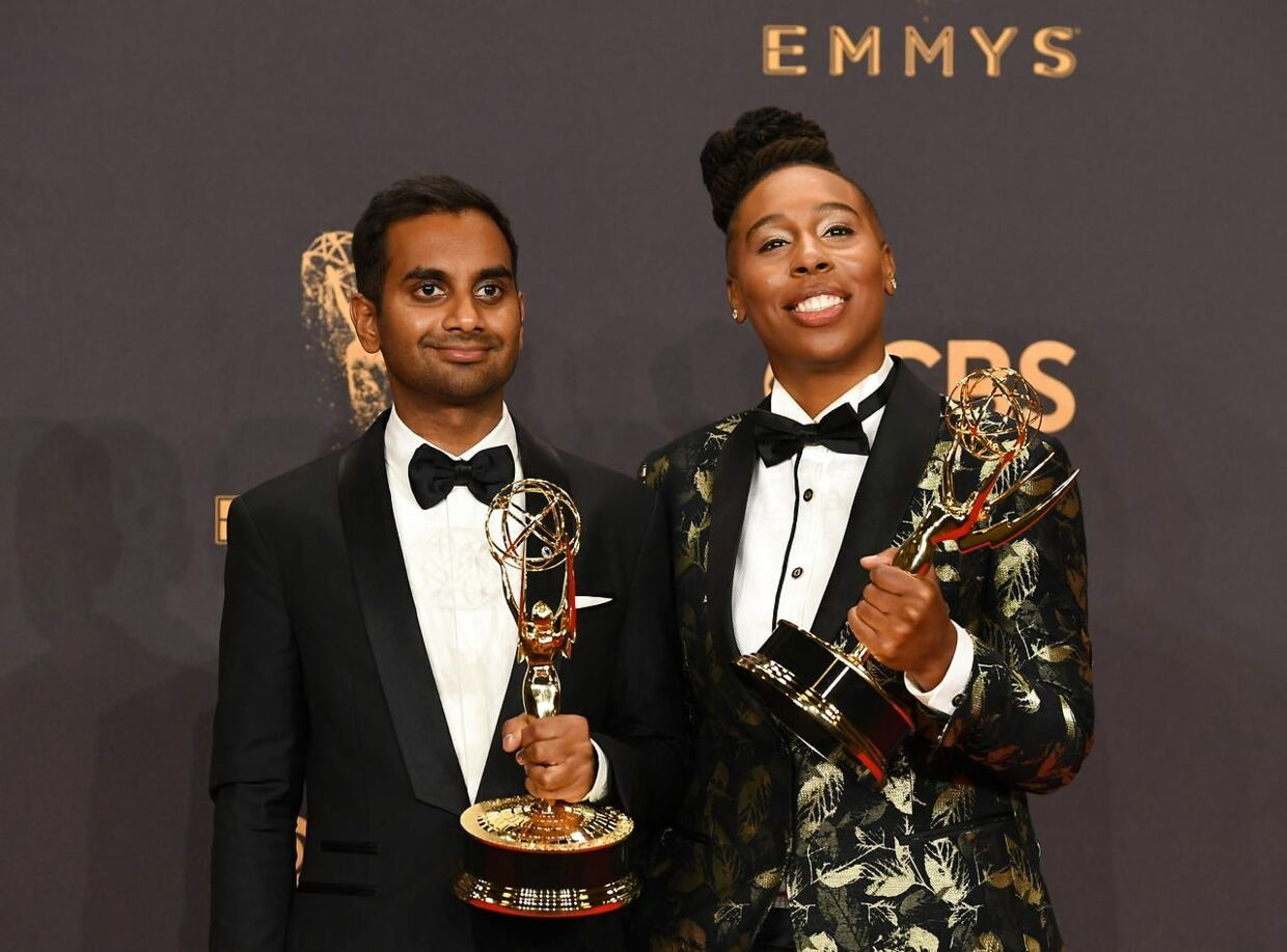 "Aziz Ansari (L) and Lena Waithe pose with the award for Outstanding Writing for a Comedy Series for ""Master of None"" during the 69th Emmy Awards at the Microsoft Theatre on September 17, 2017 in Los Angeles, California. / AFP PHOTO / Mark RALSTON"
