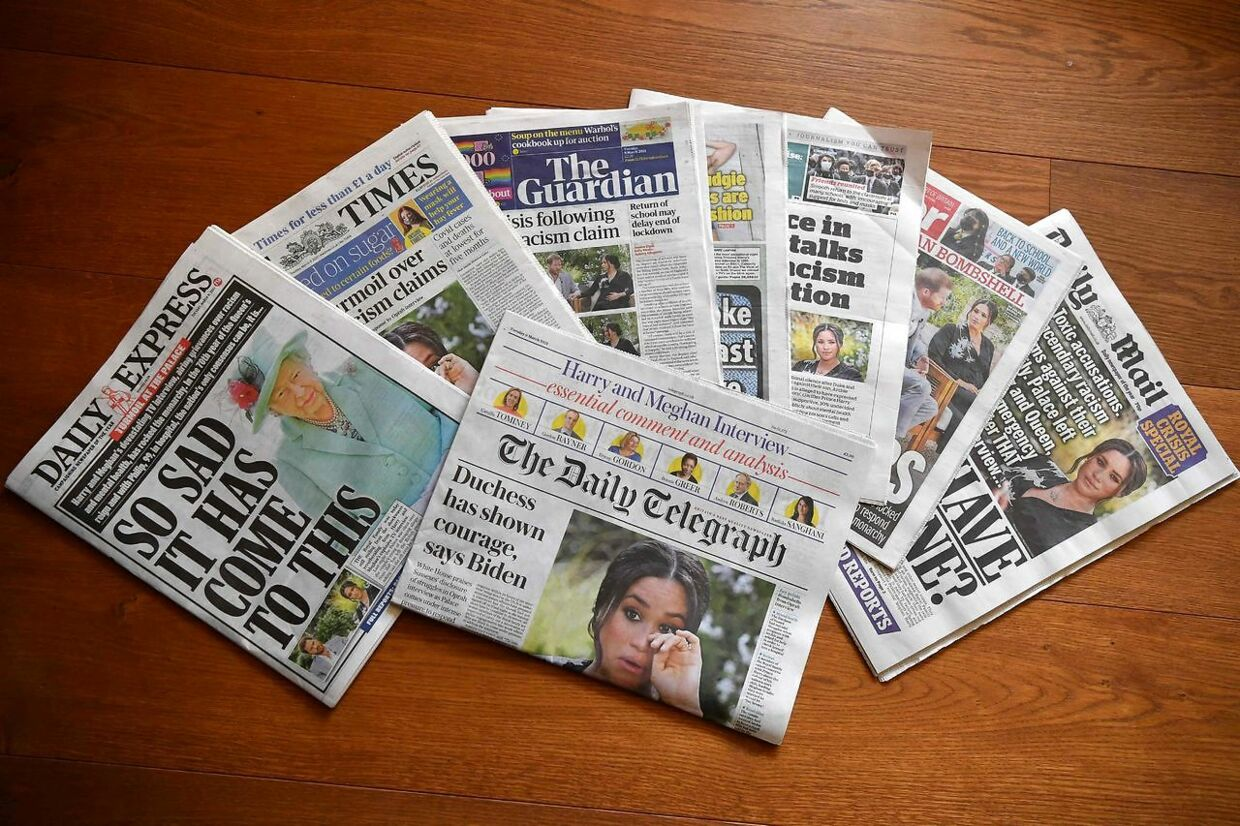 An arrangement of UK daily newspapers photographed as an illustration in Brenchley, Kent on March 9, 2021, shows front page headlines reporting on the story of the interview given by Meghan, Duchess of Sussex, wife of Britain's Prince Harry, Duke of Sussex, to Oprah Winfrey, which aired on UK broadcaster ITV. - Britain's Queen Elizabeth was in crisis talks on March 9, 2021, after Prince Harry and his wife Meghan lifted the lid on life inside Buckingham Palace with an explosive interview that reverberated around the world, local media reported. (Photo by Ben STANSALL / AFP)