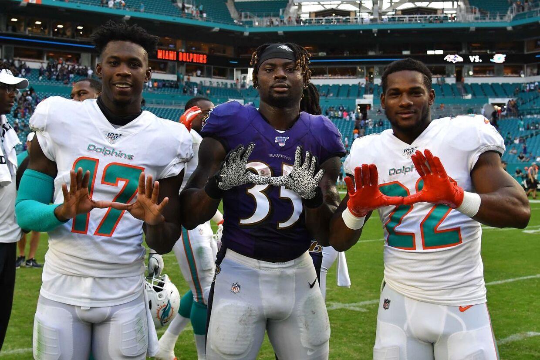 Miami Dolphins spillere. Mark Walton ses længst til højre.