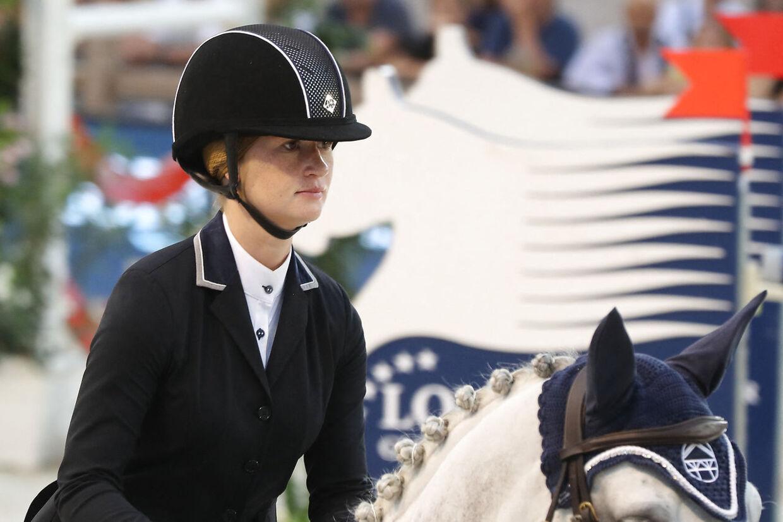 Jennifer Gates er en passionet rytter, og privat danner hun også par med den professionelle hesterytter Nayel Nassar. VALERY HACHE / AFP