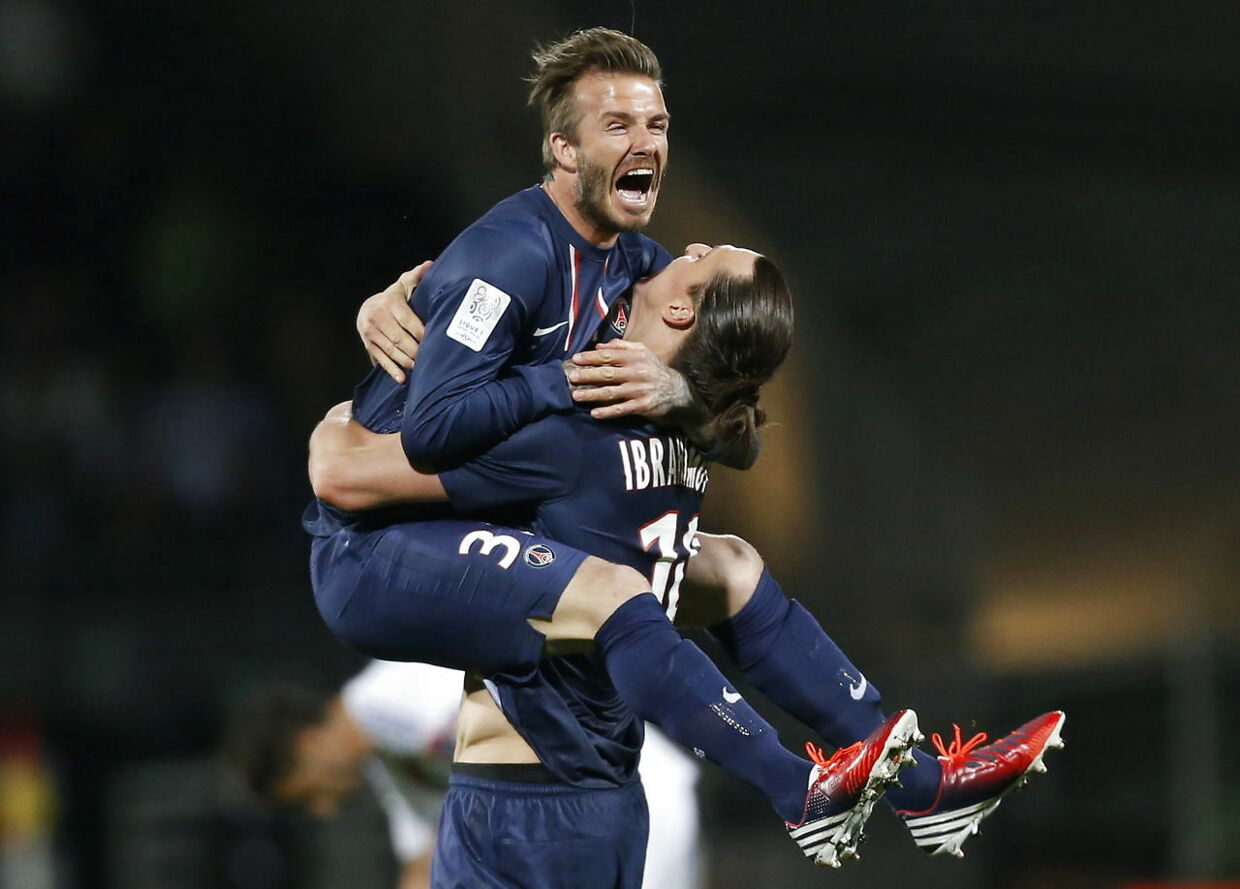 epa03920121 YEARENDER 2013 MAY David Beckham (L) and Zlatan Ibrahimovic (R) of Paris Saint Germain celebrate after their victory against Olympique Lyon in the French Ligue 1 soccer match at the Stade Gerland in Lyon, France, 12 May 2013. EPA/GUILLAUME HORCAJUELO
