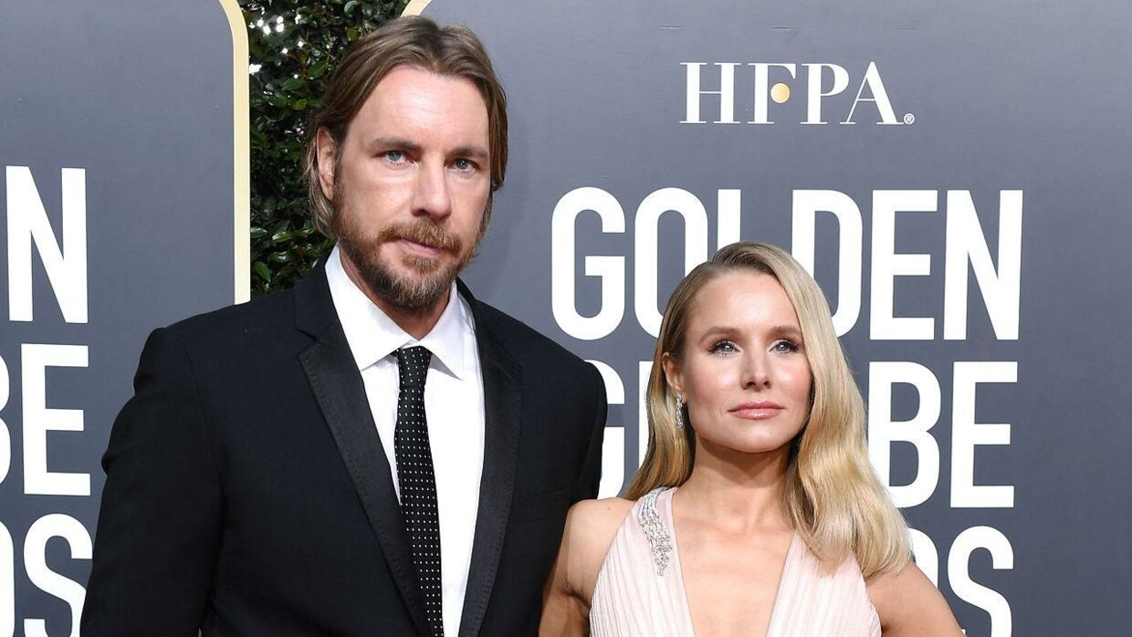 """Best Performance by an Actress in a Television Series - Musical or Comedy for """"The Good Place"""" nominee Kristen Bell (R) and husband actor Dax Shepard arrive for the 76th annual Golden Globe Awards on January 6, 2019, at the Beverly Hilton hotel in Beverly Hills, California. VALERIE MACON / AFP"""