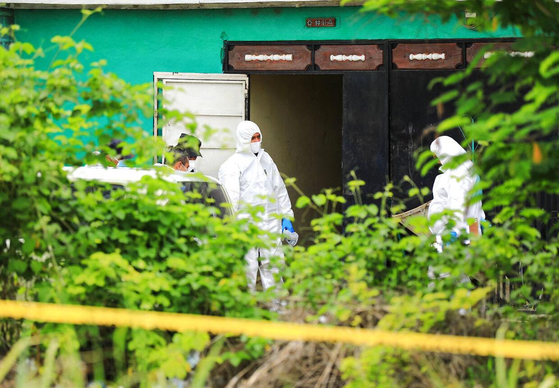 Ejendommen, hvor politiet har fundet flere nedgravede lig. (Photo by - / NATIONAL CIVIL POLICE / AFP)