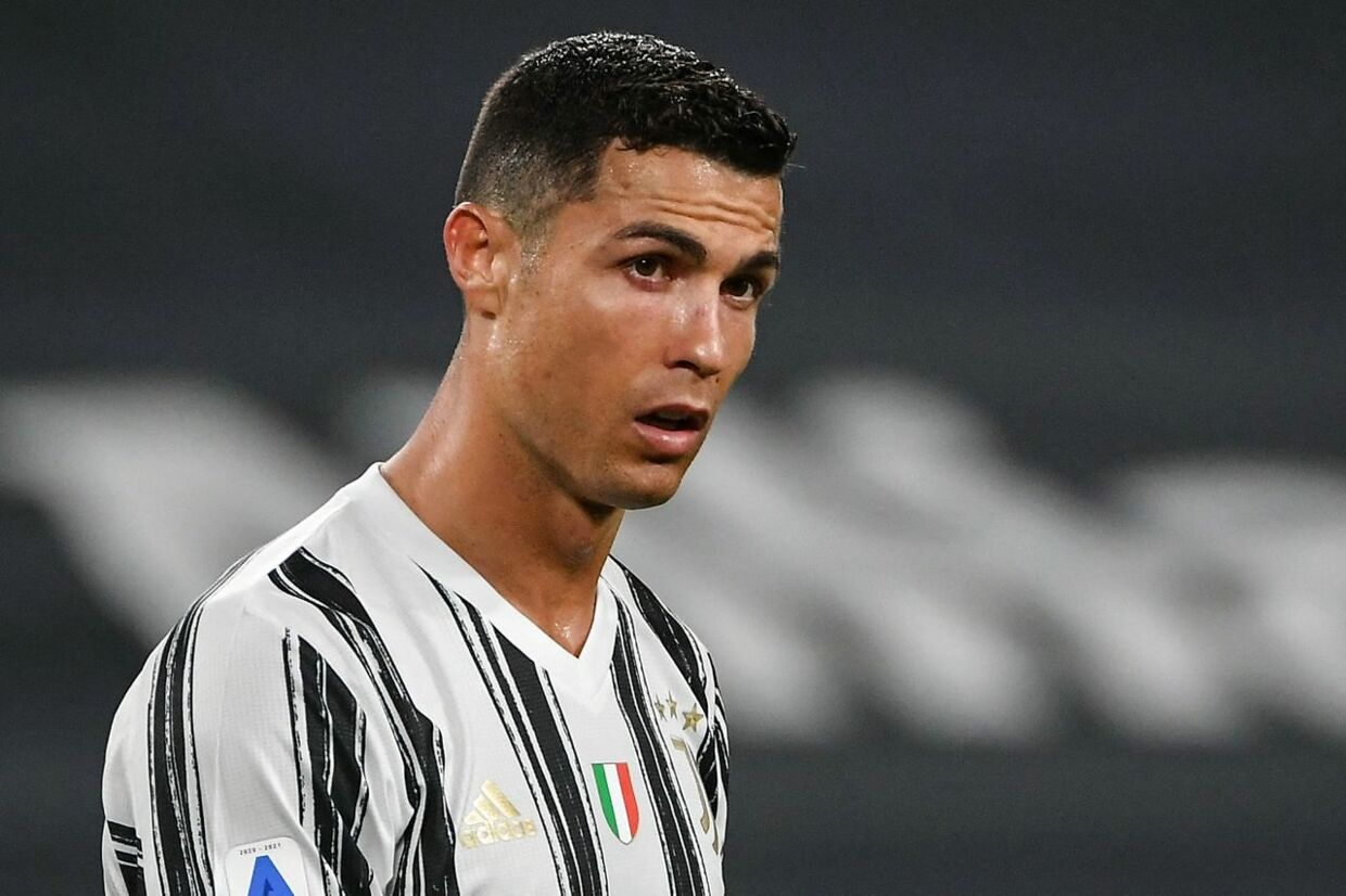 Juventus' Portuguese forward Cristiano Ronaldo reatcs during the Italian Serie A football match Juventus vs AC Milan on May 09, 2021 at the Juventus stadium in Turin. (Photo by Isabella BONOTTO / AFP)