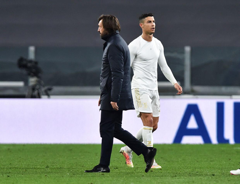 Soccer Football - Serie A - Juventus v Parma - Allianz Stadium, Turin, Italy - April 21, 2021 Juventus' Cristiano Ronaldo with coach Andrea Pirlo after the match REUTERS/Massimo Pinca