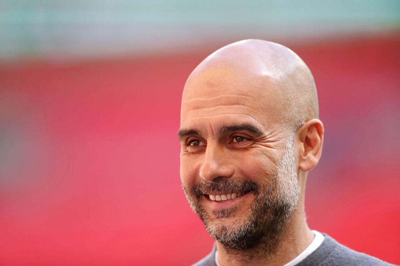 Pep Guardiola har meget at smile af. Manchester City har vundet Premier League og skal spille Champions League-finale sidst i maj.