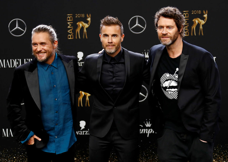 De tre tilbageværende 'Take That' medlemmer Howard Donald, Gary Barlow og Mark Owen håber, at de kan lokke Robbie Williams med på Tour. Her er de fra en koncert i 2018. Foto REUTERS/Fabrizio Bensch