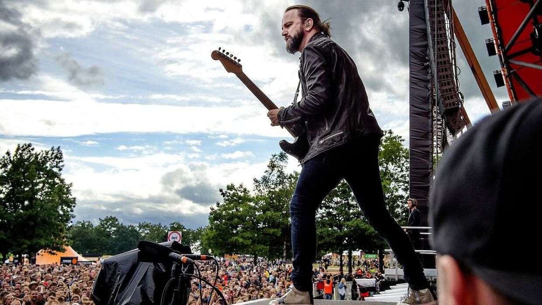 Tim Christensen har haft stor succes som musiker, både med bandet Dizzy Mizz Lizzy og som soloartist. Her ses han i front for Dizzy Mizz Lizzy på Orange Scene til Roskilde Festival i 2016.