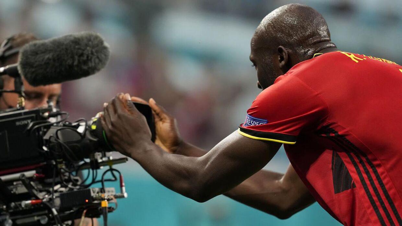 Romelu Lukaku sendte en hilsen til Christian Eriksen, da han scorede sit første mål i Belgiens 3-0-sejr over Rusland.
