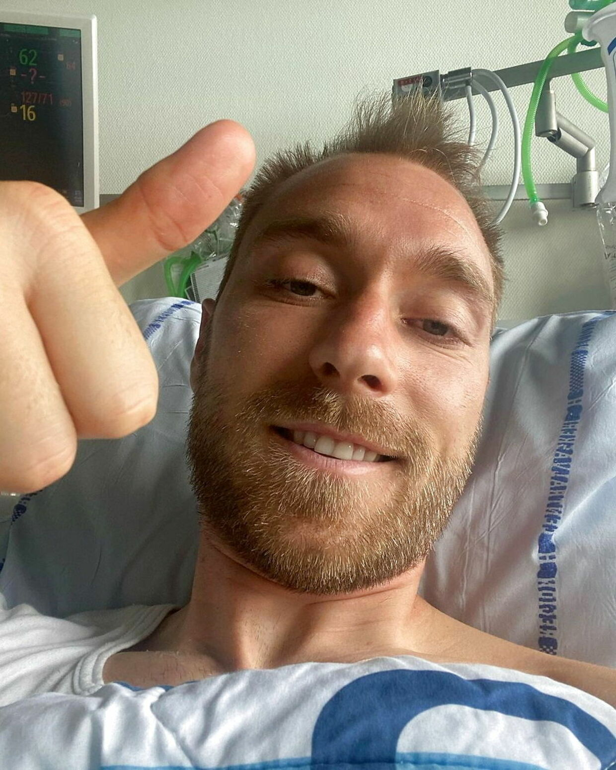 FILE PHOTO: Danish footballer Christian Eriksen gives a thumbs-up at Rigshospitalet, where he is treated after he collapsed during a UEFA Euro 2020 game on Saturday, in Copenhagen, Denmark, in this picture obtained from social media. Picture published June 15, 2021. Danish Football Association/via REUTERS THIS IMAGE HAS BEEN SUPPLIED BY A THIRD PARTY. MANDATORY CREDIT.NO RESALES.NO ARCHIVES./File Photo