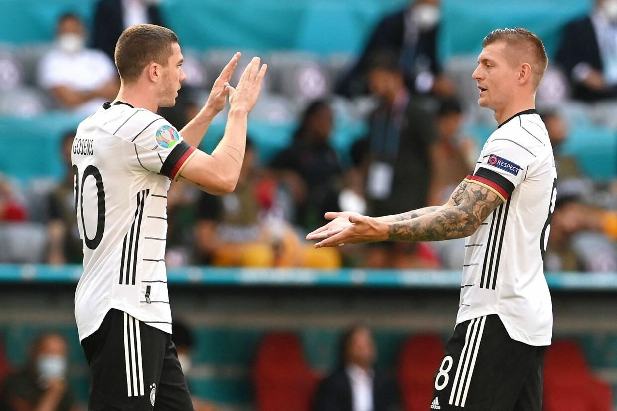 Germany's defender Robin Gosens (L) reacts with Germany's midfielder Toni Kroos before the UEFA EURO 2020 Group F football match between Portugal and Germany at Allianz Arena in Munich, Germany, on June 19, 2021. (Photo by CHRISTOF STACHE / POOL / AFP)