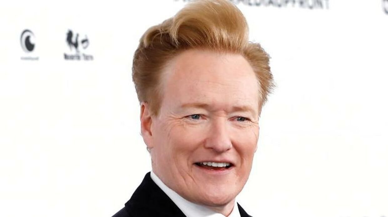 FILE PHOTO: Comedian Conan O'Brien poses as he arrives at the WarnerMedia Upfront event in New York City, New York, U.S., May 15, 2019. REUTERS/Mike Segar/File Photo