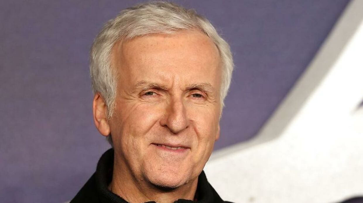 """US film director James Cameron poses for photographers upon arrival to attend the world premiere of the film """"Alita: Battle Angel"""" in London on January 31, 2019. (Photo by Daniel LEAL-OLIVAS / AFP)"""