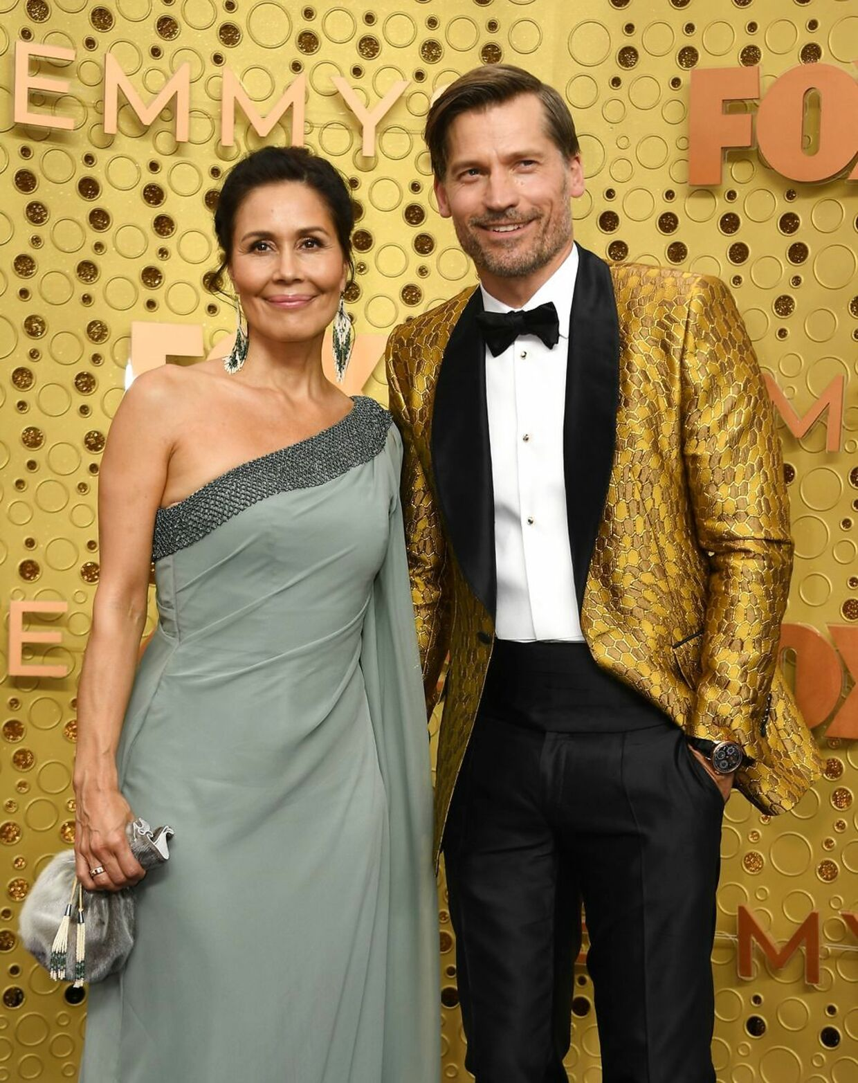 Danish actor Nikolaj Coster-Waldau and his wife Nukaaka Coster-Waldau arrive for the 71st Emmy Awards at the Microsoft Theatre in Los Angeles on September 22, 2019. (Photo by VALERIE MACON / AFP)