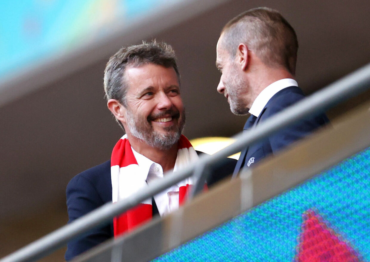 Soccer Football - Euro 2020 - Semi Final - England v Denmark - Wembley Stadium, London, Britain - July 7, 2021 Denmark's Crown Prince Frederik and UEFA President Aleksander Ceferin in the stands before the match Pool via REUTERS/Catherine Ivill